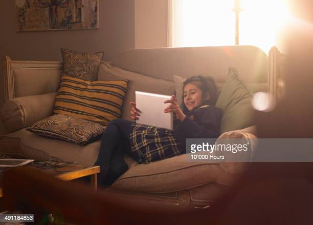 A schoolgirl at home looking at an iPad