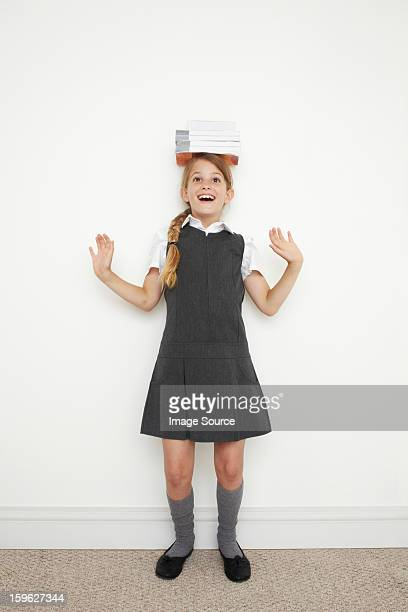 schoolgirl balancing books on her head - saltdean stock pictures, royalty-free photos & images