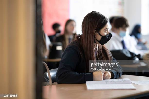 Schoolgirl during a lesson at Willows High School on March 16, 2021 in Cardiff, Wales. Secondary schools in Wales reopen this week having been closed...