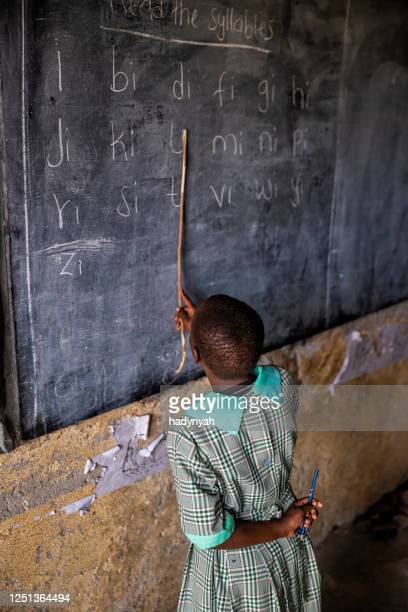 schoolgirl in a school near masai mara game reserve in kenya - native african girls stock pictures, royalty-free photos & images