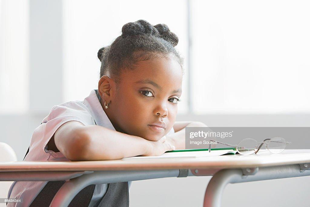 Schoolgirl in class : Stock Photo
