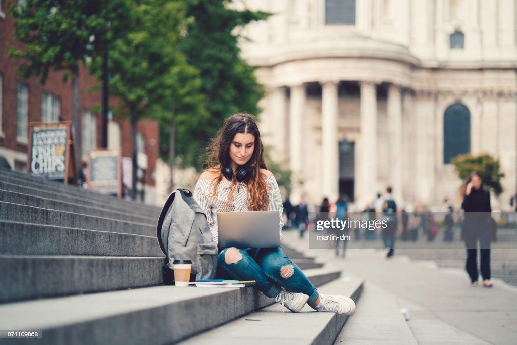 Schoolgirl in UK studying outside : Stock Photo