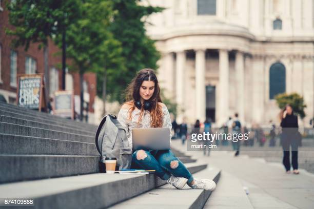 schoolgirl in uk studying outside - studentessa foto e immagini stock