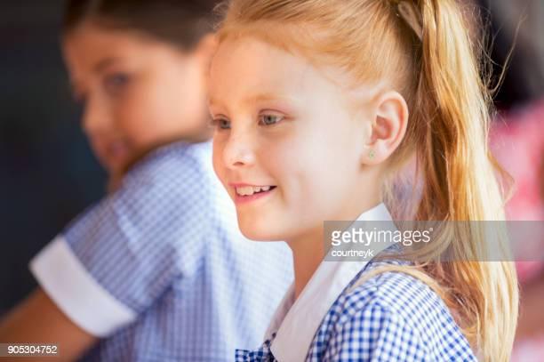 Schoolgirl in uniform.