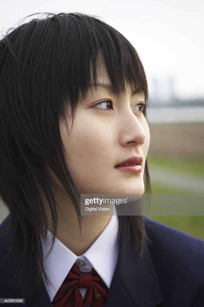 Schoolgirl Looking Sideways : Stock Photo