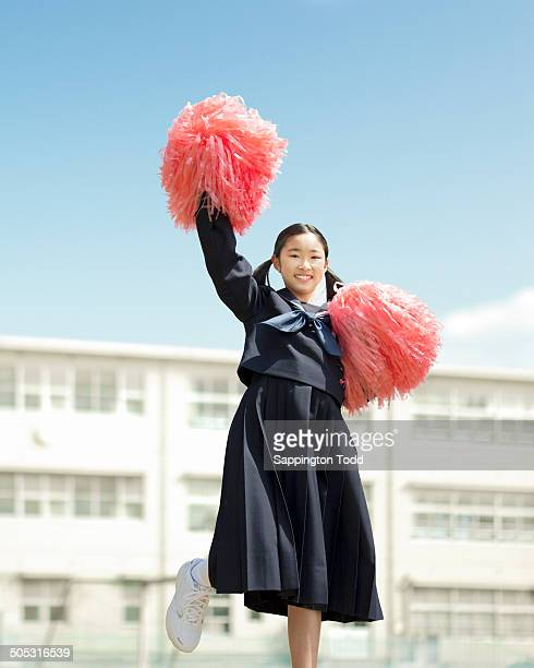 Schoolgirl Playing With Pompom