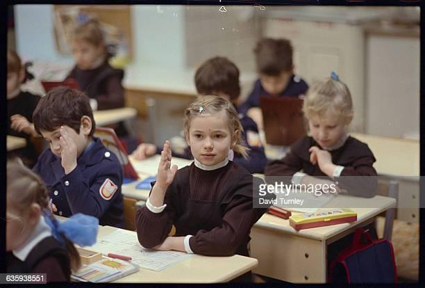 Schoolgirl Raising Her Hand