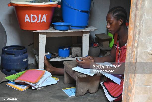 A schoolgirl receives lessons via Whatsapp in the district of Port Bouet in Abidjan on April 21 2020 A group of private college teachers teaches free...