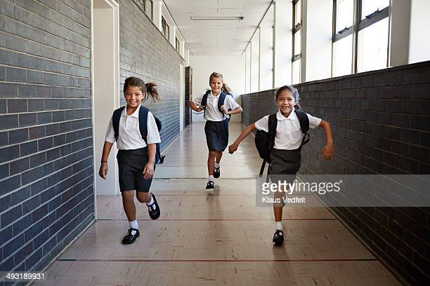 Schoolgirl running in the corridors