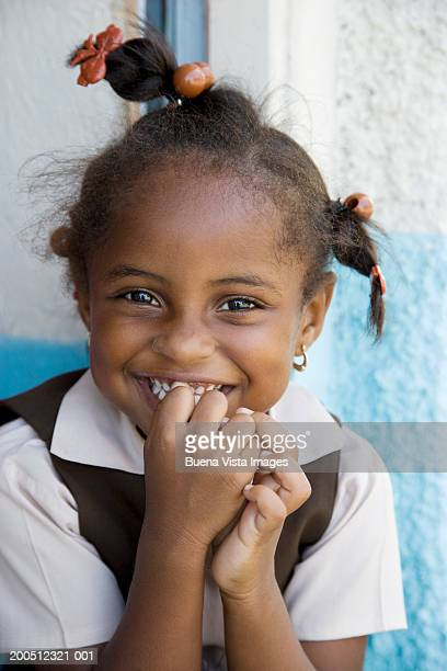 Schoolgirl (5-7) smiling, portrait