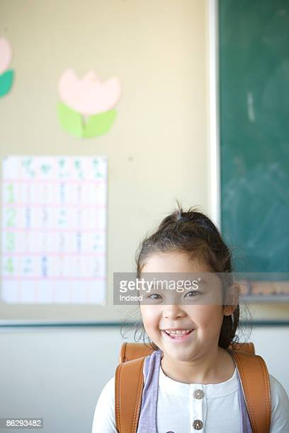 Schoolgirl smiling, portrait