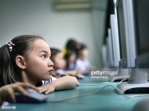 schoolgirl using computer in lab - education stock pictures, royalty-free photos & images