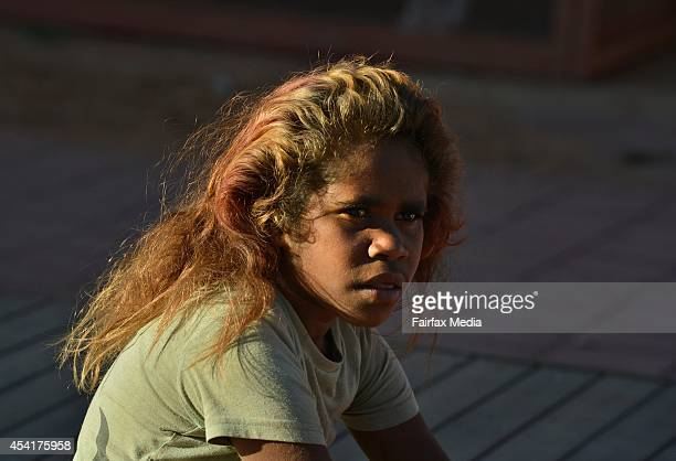 A schoolgirl waits for school assembly to start in the community of Indulkana in the Anangu Pitjantjatjara Yankunytjatjara Lands South Australia...
