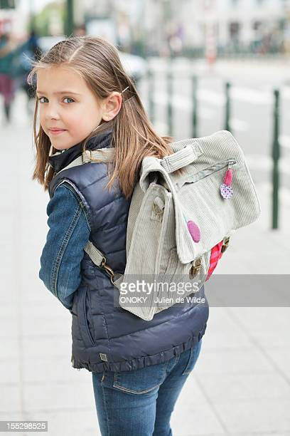 Schoolgirl walking on a footpath