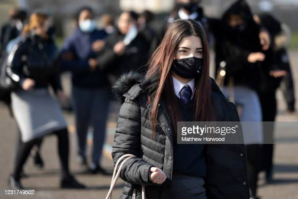 Schoolgirl wearing a face mask leaves a lesson at Willows High School on March 16, 2021 in Cardiff, Wales. Secondary schools in Wales reopen this...