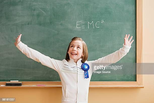 Schoolgirl wearing a rosette