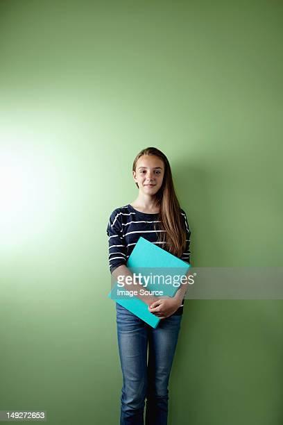 Schoolgirl with ringbinder