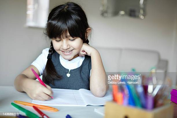 schoolgirl writing at desk - leeds stock pictures, royalty-free photos & images