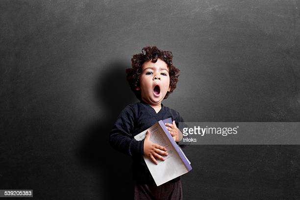 schoolgirl yawning in classroom during study - girls open mouth stock photos and pictures