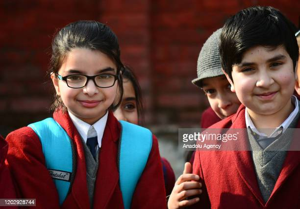 Schoolgirls assemble for the morning prayers on the first day in Srinagar Kashmir on February 24 2020 Schools across the Kashmir valley reopened...