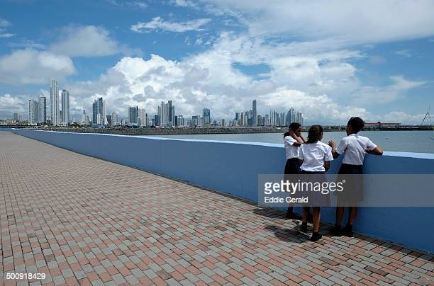 Schoolgirls at the seacoast promenade near Punta Pailtilla district, Panama City, Republic of Panama.