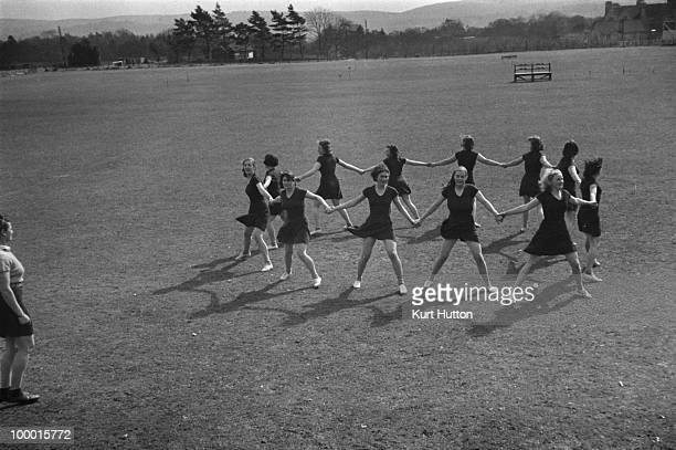 Schoolgirls in an outdoor exercise class at Bedales Boarding School in Steep Hampshire January 1941 Original publication Picture Post 403 Bedales...