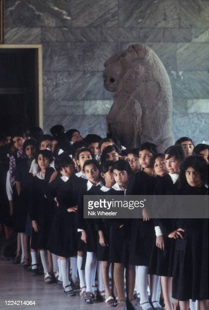 BAGHDAD JANUARY 1 Schoolgirls in school uniform line up for visit to the Iraq Museum in Baghdad circa 1978