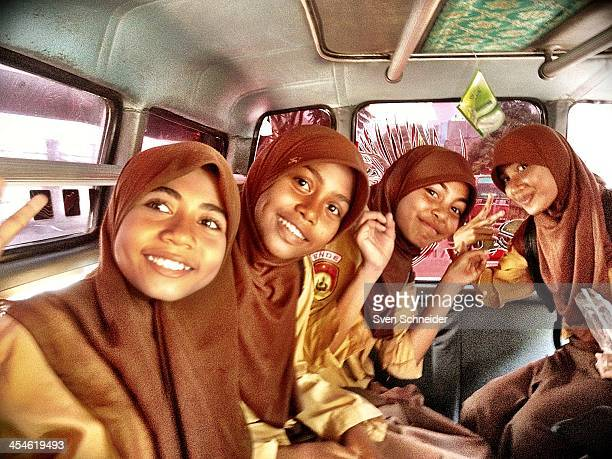Schoolgirls in the bus, at Flores indonesia