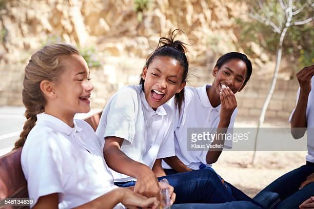 Schoolgirls laughing together in their break