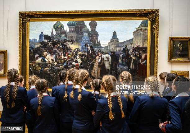 TOPSHOT Schoolgirls look at The Morning of the Streltsy Execution by Russian painter Vasily Surikov exhibited at The State Tretyakov Gallery in...