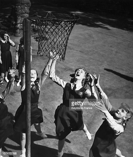 Schoolgirls Of Aida Foster School Playing A Netball Game In England