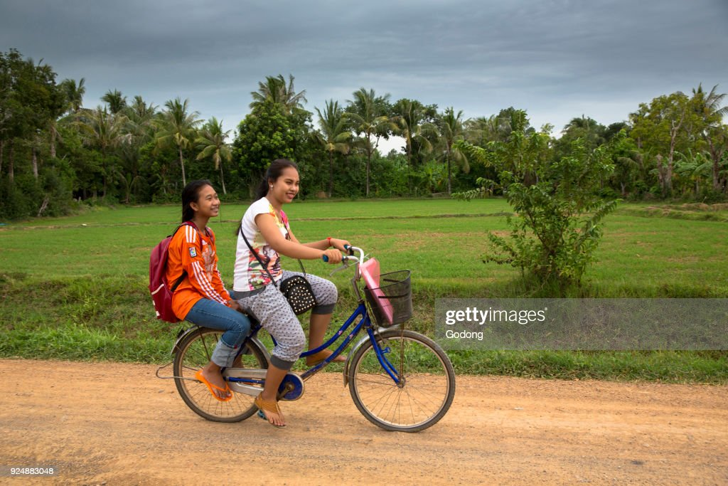 Schoolgirls on a bike. Battambang.  Cambodia. : News Photo