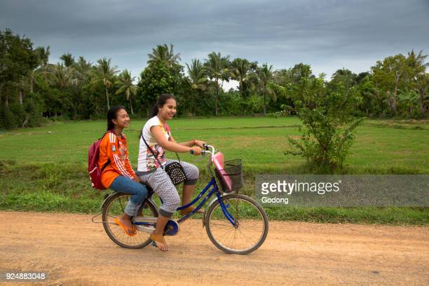 Schoolgirls on a bike Battambang Cambodia