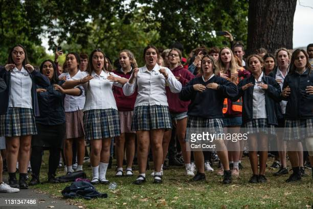 Schoolgirls perform a Haka during a students vigil near Al Noor mosque on March 18, 2019 in Christchurch, New Zealand. 50 people were killed, and...