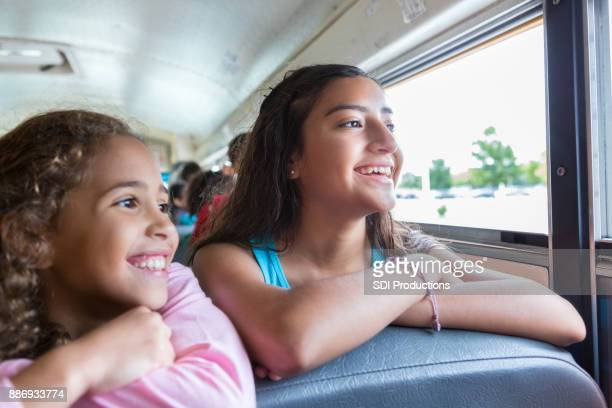 Schoolgirls ride school bus together