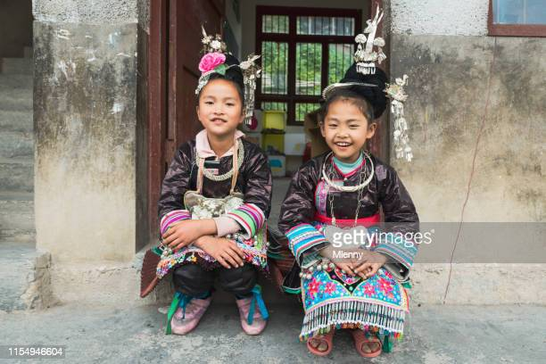 schoolgirls together traditional dong clothing, china - dong tribe stock pictures, royalty-free photos & images