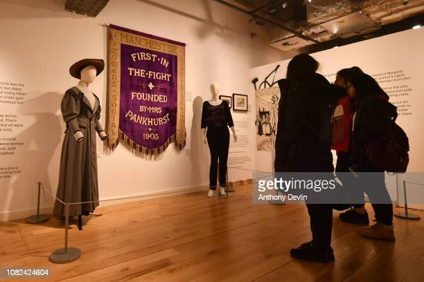 Schoolgirls view the Manchester Suffragette banner on display in the People's History Museum ahead of the unveiling of a statue of the suffragette...