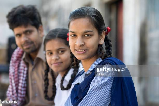 Schoolgirls with father