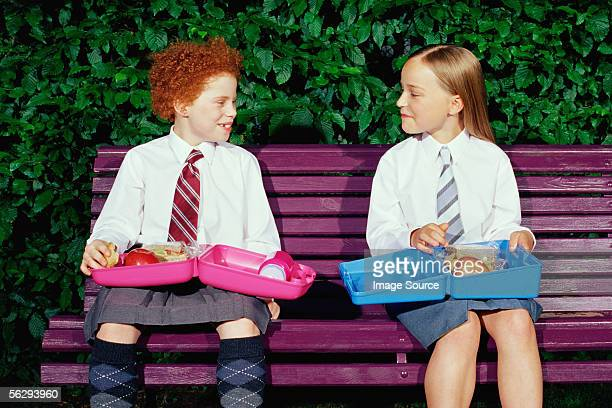 Schoolgirls with packed lunches
