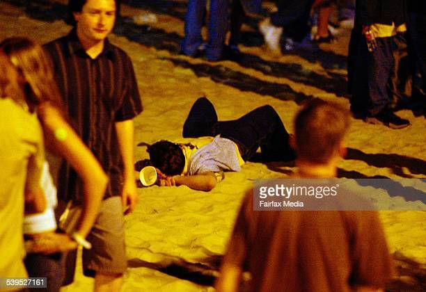 Schoolies Week hits the Gold Coast with students arriving for the famous annual holiday in Queensland Sleep time for a party goer on the beach...