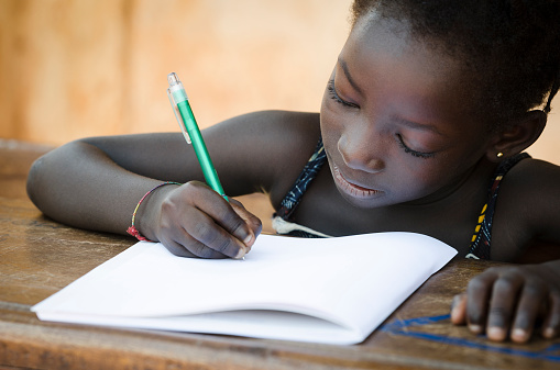 Schooling Symbol - African Young Girl Writing Notes 522079923