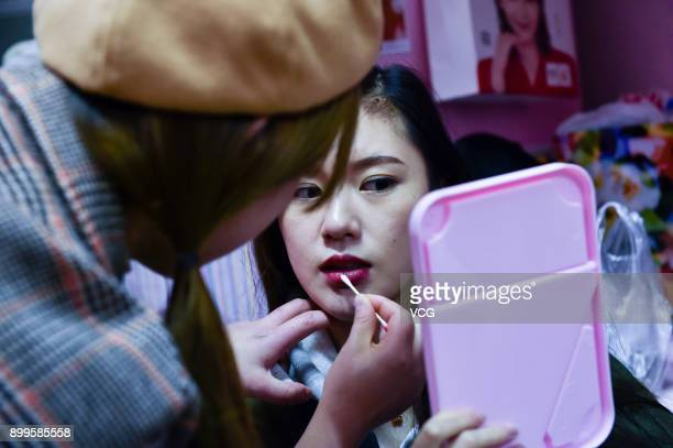 Schoolmate Fan Chuanyang helps Yu Linghan with a touchup on December 23 2017 in Chengdu Sichuan Province of China 20yearold Chinese girl Yu Linghan...