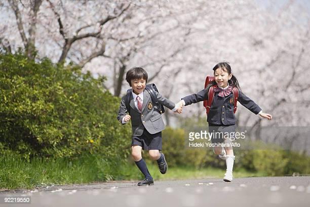 Schoolmate running on road