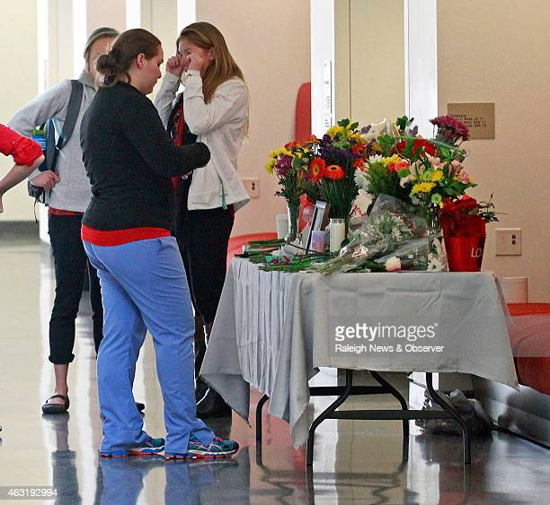 Schoolmates mourn at a makeshift memorial at the UNC School of Dentistry in the wake of the murder of Deah Shaddy Barakat and his wife Yusor AbuSalha...