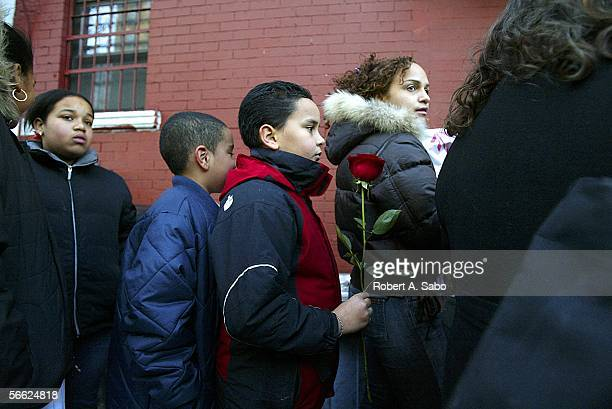Schoolmates of Nixzmary Brown Francisco Minier and Pablo Deleon wait to pay their respects at the Ortiz Funeral Home January 16 2006 in New York...