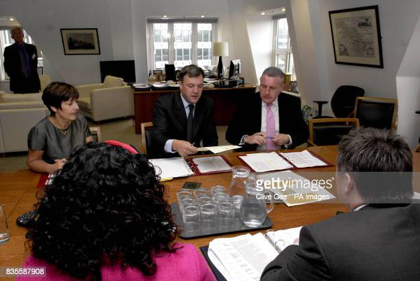 Schools Secretary Ed Balls talks with the new members of his staff Minister of State for Schools and Learners Vernon Coaker and Minister for Children...