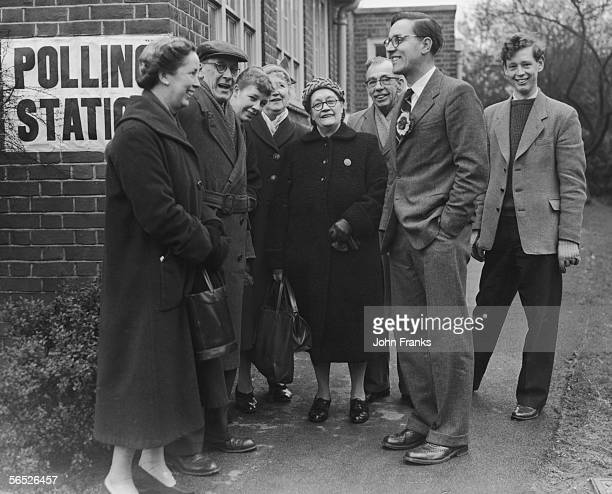 Schoolteacher and Labour candidate Merlyn Rees chatting to voters outside a polling station in East Harrow 19th March 1959