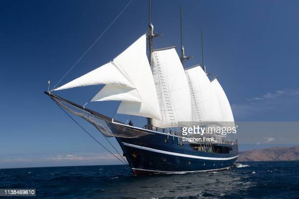schooner at sea - rinca island stock pictures, royalty-free photos & images