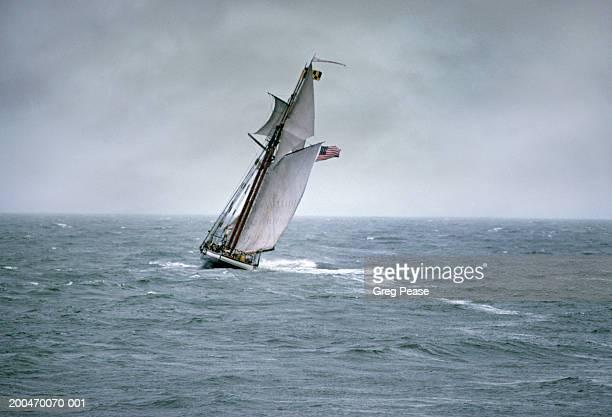 Schooner Pride of Baltimore sailing in stormy sea during rainstorm
