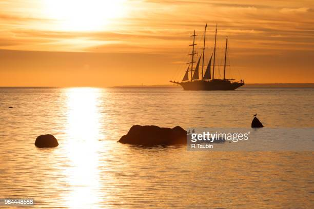 schooner silhouette at sunset in sea - pirate ship stock photos and pictures